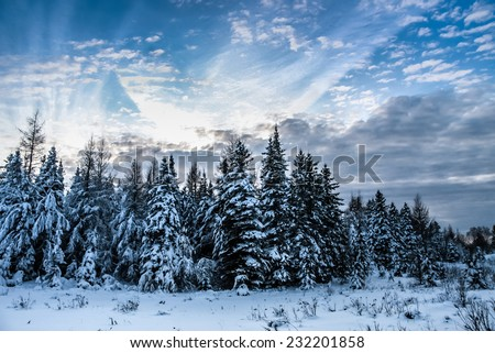 winter scene with beautiful cloudscape in rural country of Quebec, Canada - stock photo