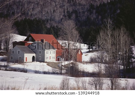 Winter scene with house and barn, VT - stock photo