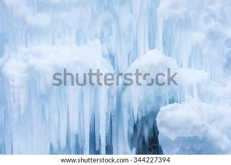 Winter scene with ice Stalactite - stock photo