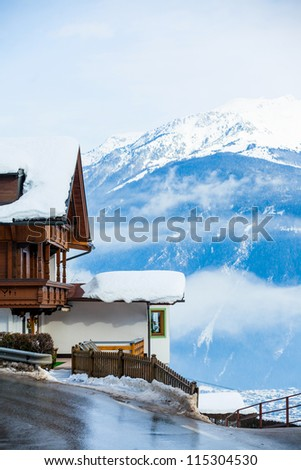 Winter scenic holiday house in austrian alps - stock photo
