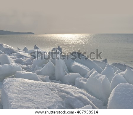 Winter,  sea,  ice  covered  with  snow  on  the  Bay  of   Vladivostok,   Primorye  , Russia