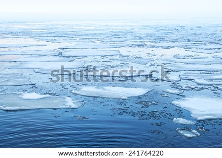 Winter Sea landscape with floating ice fragments on still cold water. Gulf of Finland, Russia - stock photo