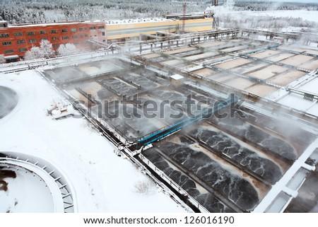 Winter season in sewerage water station - stock photo