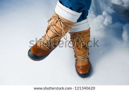 winter shoes in snow, close-up - stock photo