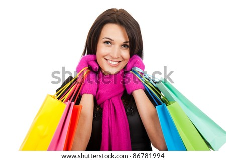 Winter shopping woman happy smiling holding bags isolated on white background.
