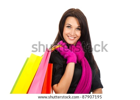 Winter shopping woman happy smiling holding colorful bags isolated on white background