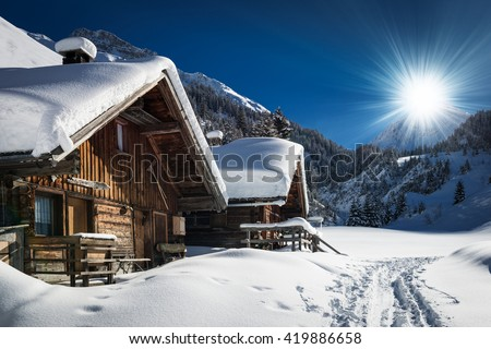 winter ski chalet and cabin in snow mountain  landscape in tyrol austria - stock photo