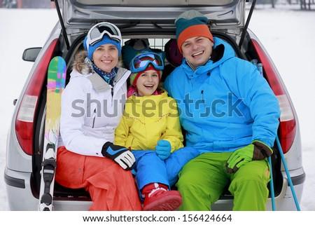 Winter, ski, journey - family with ski equipment ready for travel to ski resort - stock photo