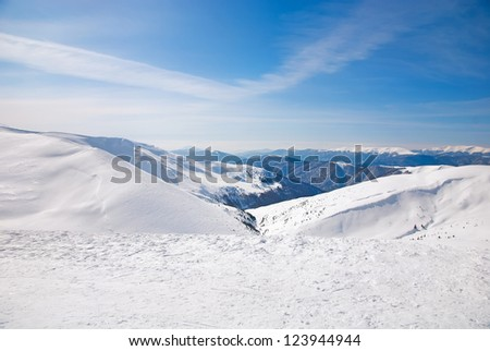 WInter ski resort snow mountains landscape with blue sky in summer sunny day - stock photo