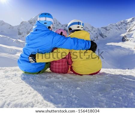 Winter, ski, skiers, snow  - family enjoying ski holiday - stock photo