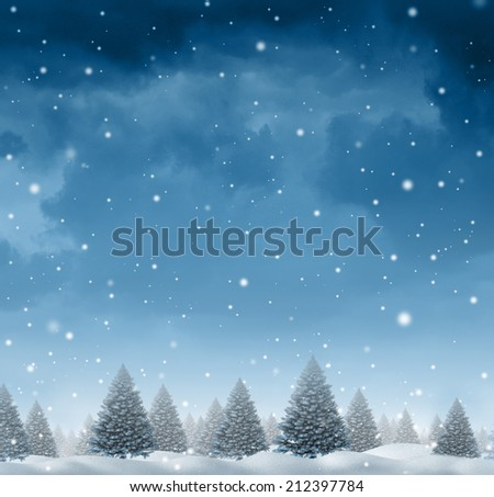 Winter snow background concept with a cold blue forest of pine trees on a snowing holiday night sky as a design element with copy space for the Christmas season and festive celebration time. - stock photo