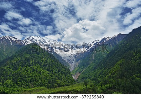 Winter snow covered mountain peaks  - stock photo