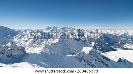 Winter snow covered mountain peaks in Europe. - stock photo