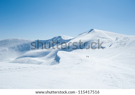 Winter snow covered mountain peaks in Europe. Great place for winter sports