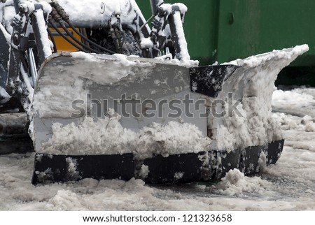Winter snow removal tractor on the street - stock photo
