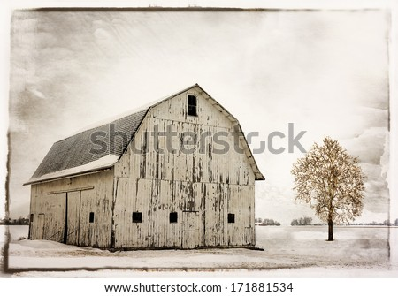 Winter snow scene with an old historic Ohio barn covered with snow.  - stock photo