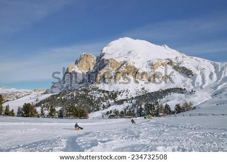 Winter, snow, sledding at winter time. Dolomites, South Tyrol, Italy - stock photo