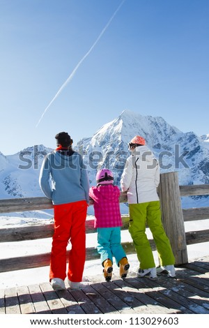 Winter, snow, sun and fun - family enjoying winter vacations (space for text)