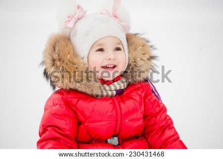 Winter, snowman - lovely girl has a fun in snow - stock photo