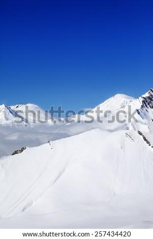 Winter snowy mountains in nice day. Caucasus Mountains, Georgia, Gudauri. View from ski resort. - stock photo