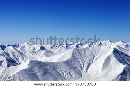 Winter snowy mountains with avalanche slope. Caucasus Mountains, Georgia, region Gudauri. - stock photo