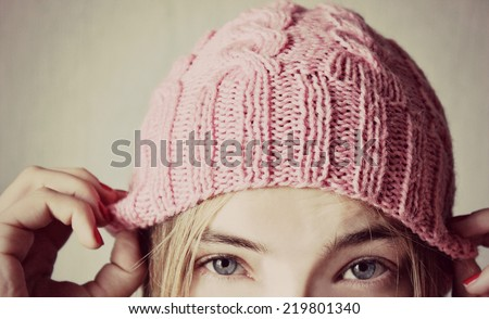 Winter soon or Knitted hat, Pink hat girl, Beautiful eyes - stock photo