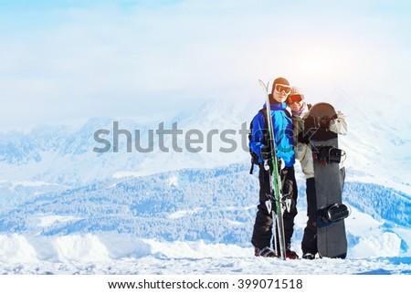 winter sports, happy young family at ski holidays - stock photo