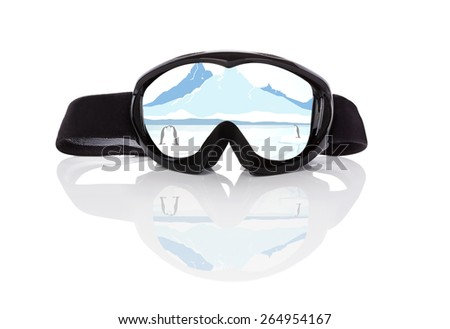 Winter sports season. Ski goggles with beautiful winter arctic landscape reflection isolated on white background. Extreme winter sports.