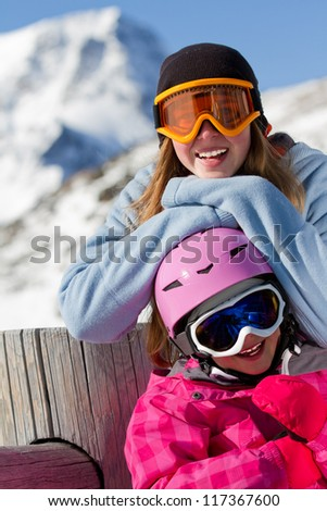 Winter sports - young skiers girl on winter vacations - stock photo