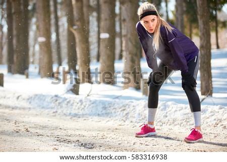winter sporty woman on break after running