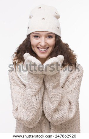 Winter studio portrait of young smiling attractive woman. Isolated on white background. - stock photo