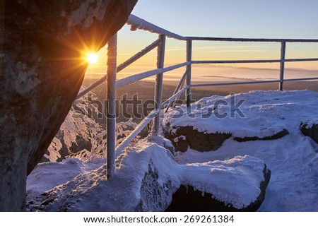 Winter sunrise in snowy mountains. Sudetes, Poland, Europe. Amazing world.