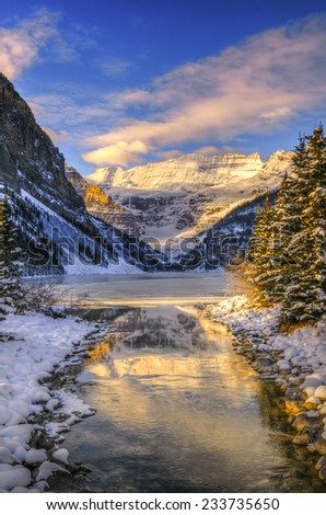 Winter sunrise over scenic Lake Louse in Banff National Park, Alberta Canada - stock photo