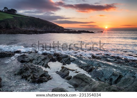 Winter sunrise over Talland bay on the Cornwall coast