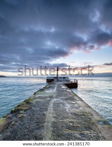 Winter sunrise over the Banjo Pier at Looe in Cornwall - stock photo
