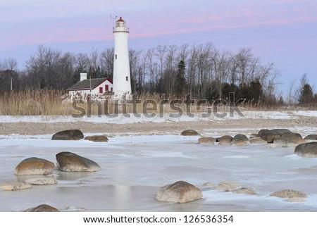 Winter sunrise Sturgeon Point Lighthouse Harrisville, Michigan USA - stock photo