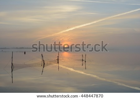Winter sunrise with fishnet at lake Veerse Meer Island: North-Beveland Province: Zeeland Country: Netherlands