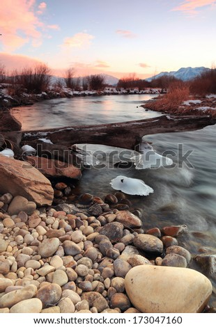 Winter sunset at the Provo River, Utah, USA. - stock photo