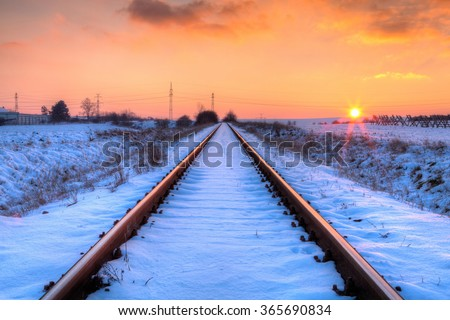 Winter sunset on the abandoned railway tracks - HDR Image - stock photo