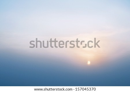 Winter sunset - the sun in the haze, horizontal