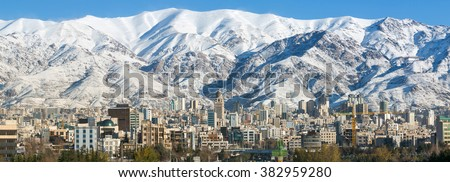 Winter Tehran view with a snow covered Alborz Mountains on background. Panorama - stock photo