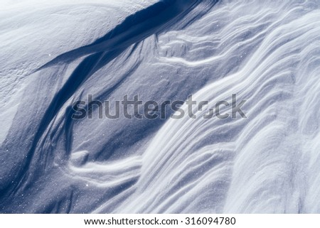 Winter texture. The snow after a snowstorm. Abstract background for design - stock photo