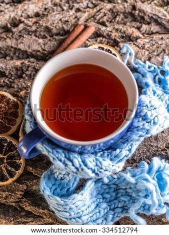 Winter time: cup of hot tea with scarf