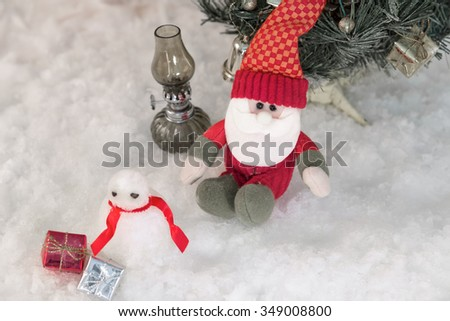 Winter time - doll of santa claus in nature in cold day,Christmas background with santa claus - stock photo