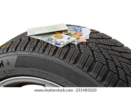 Winter tire costs - stock photo