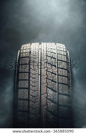 winter tire in smoke, closeup view - stock photo