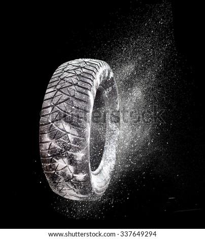 Winter tire rubber on snow. - stock photo
