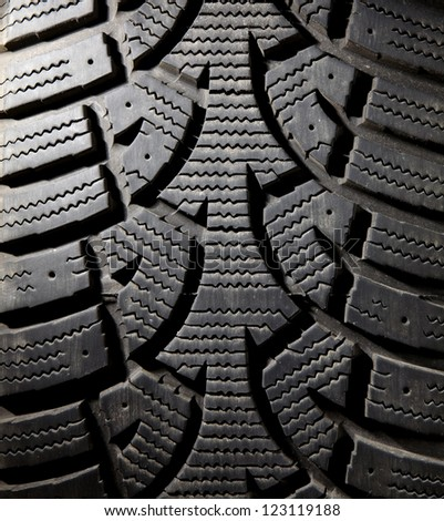Winter Tire Treads and Driving Concept.