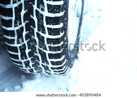 Winter tires in snow, closeup - stock photo