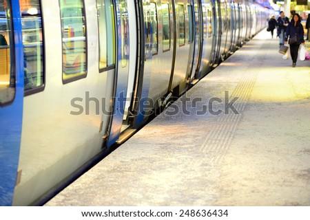 Winter train station platform - stock photo